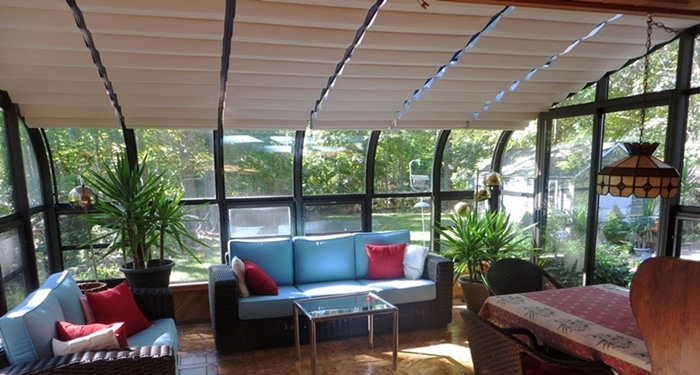 Curved solarium with our add-on track shades.